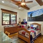 elegant boys bedroom design with wooden window frame and small desk wooden laminate flooring