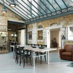 elegant square Desk Plus Black Steel Chair Pendant Lamp plus Natural Stone Wall Decor also Small Cupboard Furniture Attractive Eating Room Design With Glass Ceiling Ideas