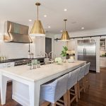 elegant white kitchen with pendants steals also interesting downlight with sectional dining furniture with silvery fridge in glossy laminate flooring large white kitche island