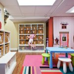 enchanting basement playroom with gorgeous rattan box storage and interesting assorted color rug with wonderful wooden wall accent for limited space idea