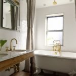 enchanting bathroom design with golden fauceet and wide grey curtan above the bathtub also energizing tile walling concept