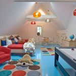 exciting room for kids with red and blue accent feat fun playing area also cozy low profile bed and unique pendant lamp and small dining set furniture in glossy laminate flooring