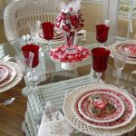 glass dining table white painted rattan dining chairs beautiful drinking glass red drinking glass white round table mat beautiful candy bucket pink floral ceramic plate wooden floor