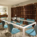 glass surfaced dining table light blue dining tables wooden wine storages wooden kitchen counter marble floor glass shelves white painted ceiling perfect furniture ideas