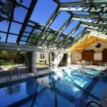 gorgeous indoor swimming pool with enchanting iron roofing also cute dining set furniture