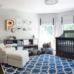 gorgeous nrusery room with sturdy black crib and elegant white sofa and interesing arc lamp with magnificent motif rug also gorgoeus framed white window