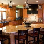 gorogeus kitchen remodeling ideas with wonderful wooden kitchen cabinet also interesting glossy granite top table with elegant dark brown chairs in hardwooden flooring concept