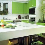 green kitchen cabinets white kitchen countertop  green leafy plants organic and fresh food white backsplash healthier and greener kitchen