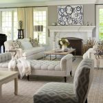 hardwood flooring white ceiling grey wall cream curtains white sofa white console chair white table wood coffee table white fireplace silver floor lamp black grand piano beige geomterical patterned rug