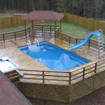 in-deck recangular swimming pool wooden deck floor small wooden gazebo small refreshing jacuzzi wooden fench small swimming pool idea