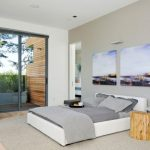 interesing modern house concept feat low profile teak wood bed with beutral grey backdrop also amaazing sliding glass doors desin in laminate flooring