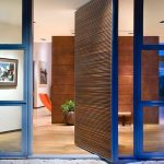 interesting front door with gorgeous blue accent and wonderful wooden wall divider and interesting hardwooden flooring concept