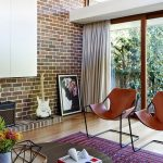 interesting iron and leather chairs also magnificent wall brick design with elegant turkey rugs with sophisticated framed foor in laminate flooring