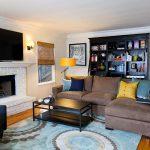 interesting masculine living room wall mount tv gorgeous rustic sofa cute black table wonderful large bookshleve beautiful warm rug interesting wall fireplace in laminate flooring