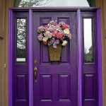 interesting purple front door with cute flower decoration mounted on the door also ravishing welcoming mat for modern house design