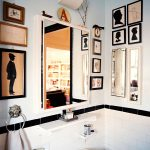 intereting bathroom style with amazing artistic wall decoration also wonderful large hanging mirror with elegant white sink