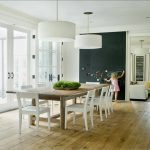 light wooden floor white painted wall chalk painted wall wooden dining table white painted dining chair white pendant lamp shade white painted door frame light creame painted wall