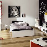 light wooden varnished floor black painted wall white painted wall cute wallsticker white wooden bedframe white wooden storages white wooden wardrobe teen bedroom decor