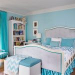 lovely teeenage bedroom design with blue and white shooting combination also interesting large bookshleve with standing lamp also blue armchair in laminate flooring