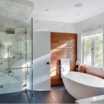 magnificent japanese bathroom with eelgant white bathtub also interesting large glass shower with unique wooden wall panel also white painted wall in granite flooring