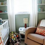 magnificent small nursery room with gorgeous white crib and magnificent brown sofa and interesting wall mount shelve also large framed window in soft blue wall decal
