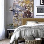 minimalist bedroom interor with gorogeus abstract painting and cozy teak wooden bed and tavishing gray sheet with wonderful wall panel in rustic varnished flooring