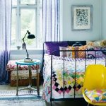 mint painted wall light purple curtain black ironed bedframe wooden nightstand black metal table desk patchworked bedspread bright yellow chair stripes rug