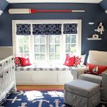 Modern Baby Nrusery Idea With Sea Inspired Theme Elegant White Crib Stripe Wall With Blue And White Accent Also Interesting Window Seat Position And Cosy Large Sofa With Decorative Rug