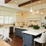 modern kitchen style with gorgeous l-shaped kitchen island also interesting white chairs and amazing creamy wall color decoration in glossy laminate flooring