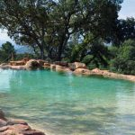 natural inground swimming pool with amazing stone paving concept also grogeus water flow for saving environment