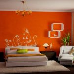 orange painted wall dark wooden floor creame floor rug white painted ceiling white bedframe white chair white shelves orang simple chandelier orange bedroom color warm color for bedroom
