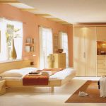 pale orange painted wall white ceramic floor particleboard bed frame particleboard storages particleboard wardrobe brown floor rug beautiful bedroom color ideas
