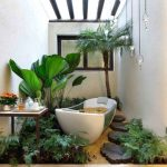 patterned wall skylighted ceiling rustic wooden footpath small palm tree tropical plants bron bathroom table vessel bathtub beautiful pendant lamp bathroom plant options