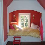 pink wall pink chair white framed window white and gold sconces white wall mounted shelf white bed frame yellow gold bed sheet pink white pillow hardwood flooring gold pillow