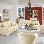 red painted wall white painted wall gold vintage mirror and counter black majestic chandlier white floral patterned sofa set traditional classic coffee table white painted ceiling