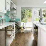 stunning Small Kitchen Design also Blue Backsplash Concepts Exhausting Wood Floor Additionally Mirror Base Cupboard