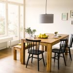 superb Black Metal Dining Chair In Atrractive Eating Room Design With Spherical Pendant Lamp and Picket Laminate Flooring plus Vast Glass Window Amusing Picket Dining Desk