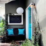 unique blue door with interesting black bench and cute blue cushion also amazing chakboard on the wall with unique japanese inspired pendant lamp