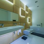 white hanging sink white ceiling white floor plan white bath tub white toilet black long mat modern silver faucets white towel unique wood wall wall LED lighting