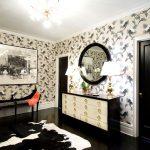 white painted ceiling floral patterned wallpaper black painted interior doors black drawers beautiful desk lamps round black framed mirror black ceramic floor animal skinned floor rug