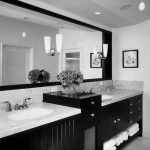 White Painted Wall Single Long Black Framed Mirror Two Minimlaist Pendant Lamps Marble Countertop Double White Sinks Double Faucets Simple Pendant Lamp  Black Wooden Storage Glass White Framed Door