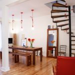 White Wall Laminated Wooden Floor Wood Benches Woo Table Wood Framed Mirror Wood Chair Red Armchair Red Pendant Lamps Whote Curtain Wood And Steel Stairs