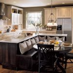 wonderful classic kitchen design with built in dining area also elegant beige cabinet with interesting pendant lamp in rustic wooden flooring design