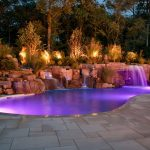 wonderful rectable pool with fiberglass and magnificent stone and intereting small waterfalls in flagstone paving design