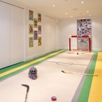 wonderful sport inspired kids room with interesting hockey carpeting and magnifeicent downlights with neutral white backdrop