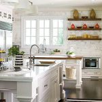 wonderful white kitchen design with open shelve on the wall also elegant white tile countertop and undermount sink with gorogeus stone walling in laminate flooring