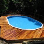 wooden deck floor natural surroundings lush vegetation scenic view small swimming pool idea