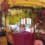 wooden green painted wall red chandelier yellow painted ceiling floral cushion wrapped natural element decorations rustic desk pink bedspread floral bedspread beautiful small lantern