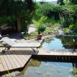 wooden pool bridge wooden garden chair green surroundings stony pool floor gorgeous natural swimming pool for house