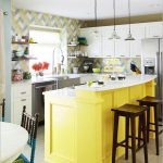 yellow painted kitchen counter dark woodenbar stool white marble kitchen countertop colorful backsplash colorful backdrop white kitchen cabinter brown ceramic tiled floor colorful kitchen design ideas